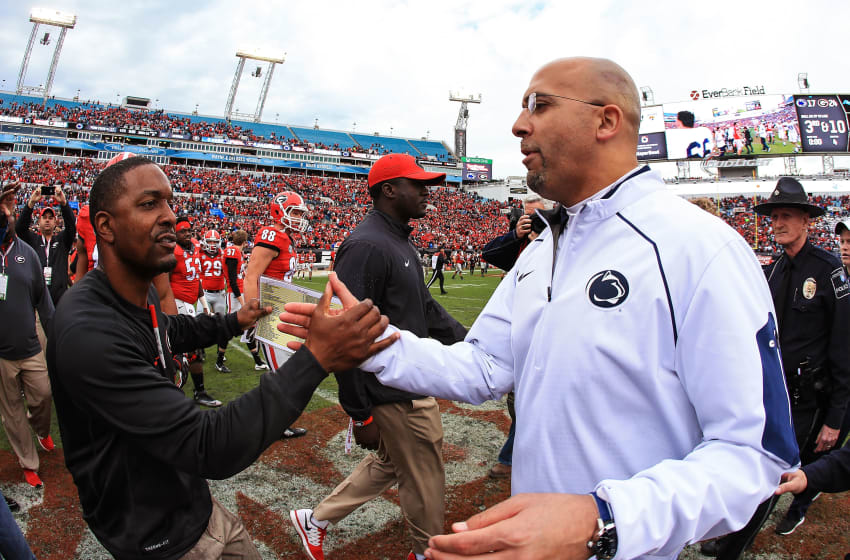 JACKSONVILLE, FL - JANUARY 02: Now South Carolina football assistant, Bryan McClendon shakes hands with and James Franklin of the Penn State Nittany Lions shake hands after the TaxSlayer Bowl.. (Photo by Rob Foldy/Getty Images)