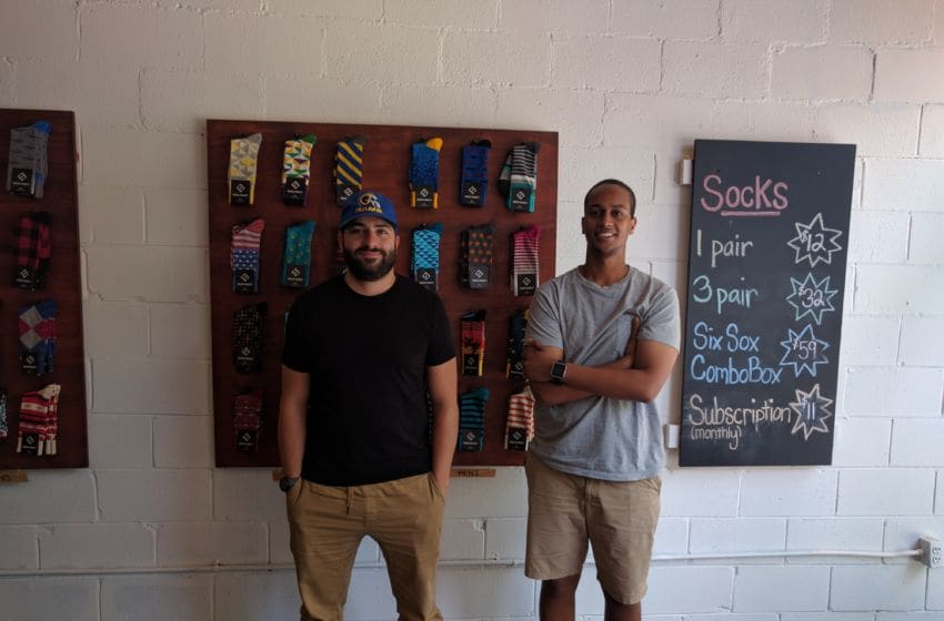 Sock Fancy co-owners Stefan Lewinger (L) and Futhum Tewolde. Photo credit: Tiffany M. Davis for Local POV.