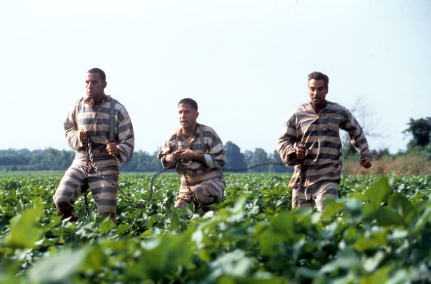 John Turturro, Tim Blake Nelson and George Clooney run through a field in a scene from the film 'O Brother, Where Art Thou?', 2000. (Photo by Universal/Getty Images)