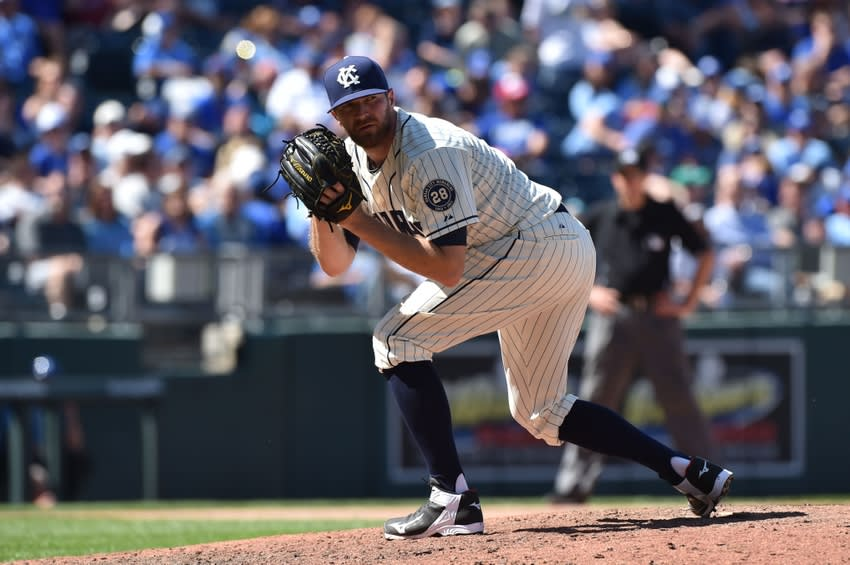 May 17, 2015; Kansas City, MO, USA; Kansas City Royals pitcher Wade Davis (17) takes a look at the runner at first against the New York Yankees during the eighth inning at Kauffman Stadium. Mandatory Credit: Peter G. Aiken-USA TODAY Sports