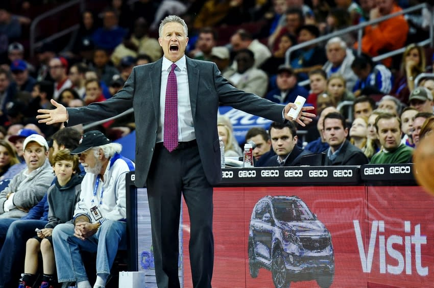 Mar 20, 2016; Philadelphia, PA, USA; Philadelphia 76ers head coach Brett Brown shots at players during the first quarter of the game against the Boston Celtics at the Wells Fargo Center. Mandatory Credit: John Geliebter-USA TODAY Sports