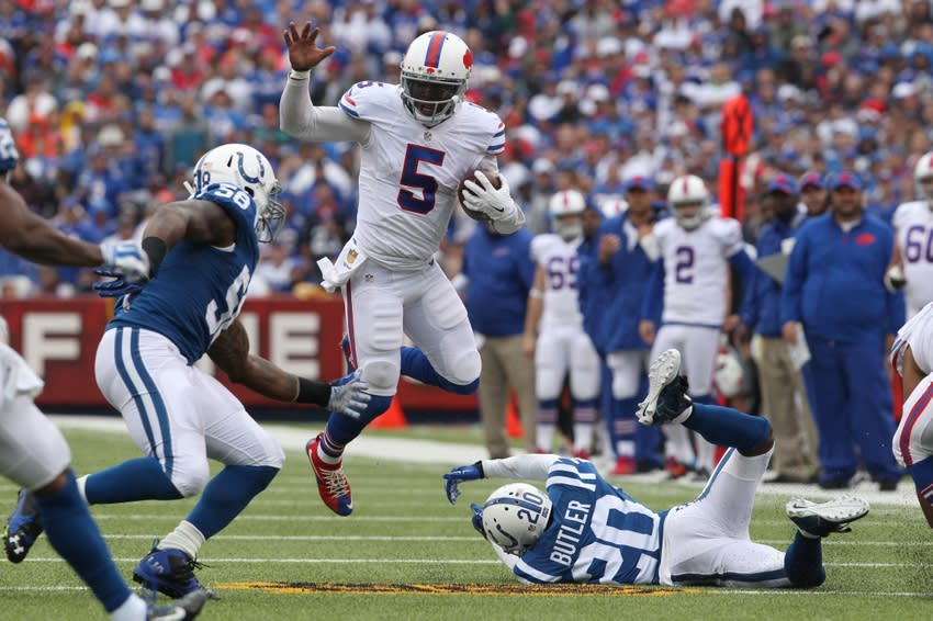 Sep 13, 2015; Orchard Park, NY, USA; Buffalo Bills quarterback Tyrod Taylor (5) jumps to avoid a tackle during the first half against the Indianapolis Colts at Ralph Wilson Stadium. Mandatory Credit: Timothy T. Ludwig-USA TODAY Sports