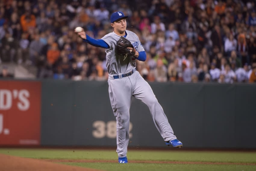 September 28, 2015; San Francisco, CA, USA; Los Angeles Dodgers shortstop Corey Seager (5) throws the baseball to first base during the first inning against the San Francisco Giants at AT&T Park. The Giants defeated the Dodgers 3-2 in 12 innings. Mandatory Credit: Kyle Terada-USA TODAY Sports