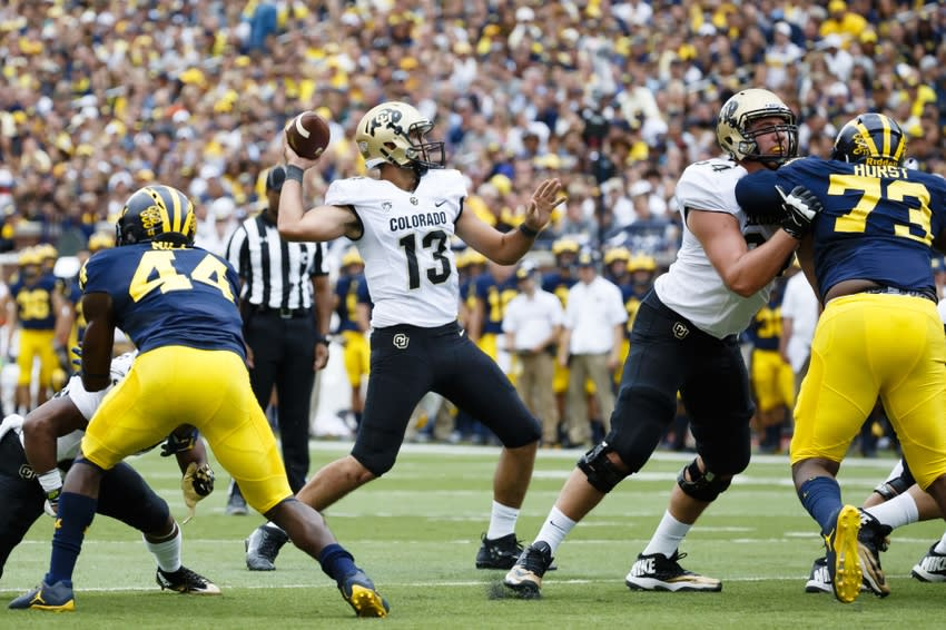 Sep 17, 2016; Ann Arbor, MI, USA; Colorado Buffaloes quarterback Sefo Liufau (13) passes for a touchdown in the first quarter against the Michigan Wolverines at Michigan Stadium. Mandatory Credit: Rick Osentoski-USA TODAY Sports