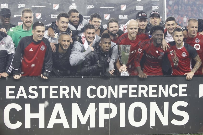 Nov 30, 2016; Toronto, Ontario, CAN; Toronto FC pose with the Eastern Conference trophy after defeating the Montreal Impact in the second leg of the MLS Eastern Conference Championship at BMO Field. Toronto defeated Montreal 5-2. Mandatory Credit: John E. Sokolowski-USA TODAY Sports