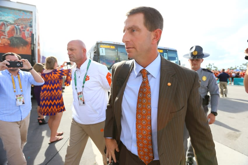 Dec 31, 2015; Miami Gardens, FL, USA; Clemson Tigers head coach Dabo Swinney walks from the buses as he and his team arrive for the 2015 CFP Semifinal at the Orange Bowl against the Oklahoma Sooners at Sun Life Stadium. Mandatory Credit: Steve Mitchell-USA TODAY Sports