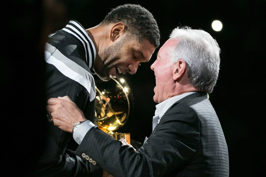 Oct 28, 2014; San Antonio, TX, USA; San Antonio Spurs power forward Tim Duncan (21) gets his championship ring from team owner Peter Holt (right) during a ceremony before the game against the Dallas Mavericks at AT&T Center. Mandatory Credit: Soobum Im-USA TODAY Sports