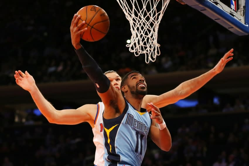 Mar 23, 2015; New York, NY, USA; Memphis Grizzlies guard Mike Conley (11) drives to the basket past New York Knicks forward Lou Amundson (21) during the first half at Madison Square Garden. Mandatory Credit: Adam Hunger-USA TODAY Sports