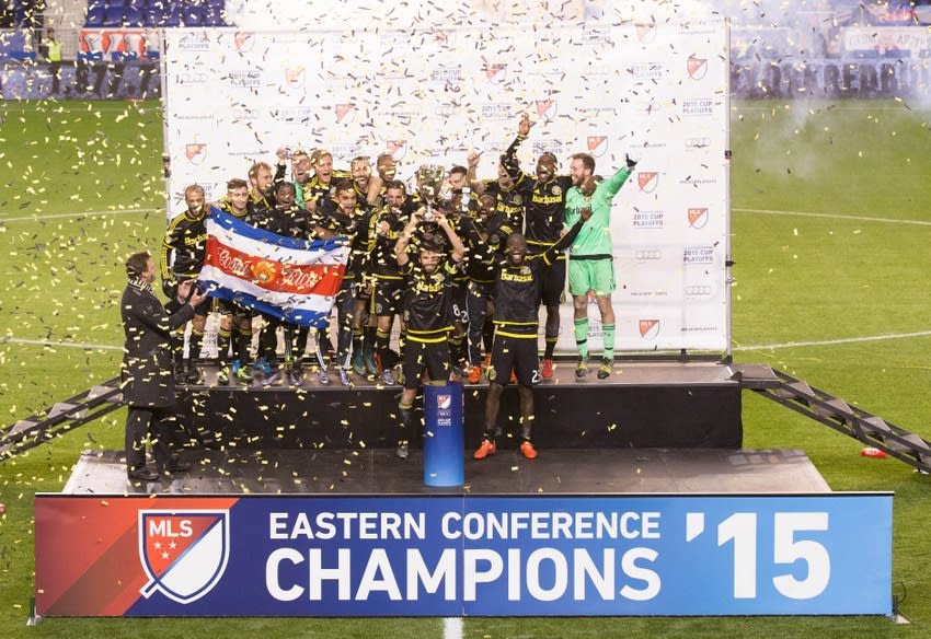 Nov 29, 2015; Harrison, NJ, USA; The Columbus Crew win the Eastern Conference Championship and raise the trophy as they celebrate their victory against the New York Red Bulls at Red Bull Arena. The Columbus Crew won with an aggregate score of 2-1. Mandatory Credit: Bill Streicher-USA TODAY Sports