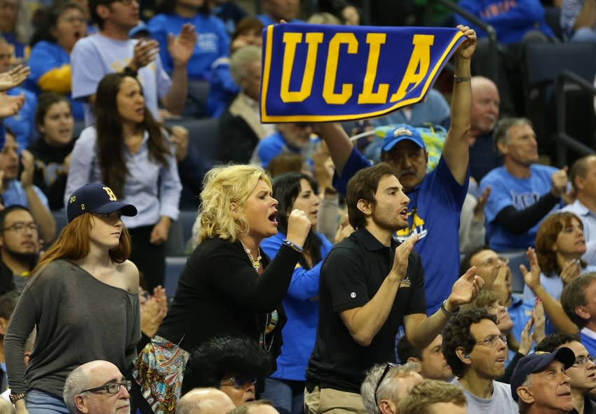 Mar 27, 2014; Memphis, TN, USA; UCLA Bruins fans cheer during the second half against the Florida Gators in the semifinals of the south regional of the 2014 NCAA Mens Basketball Championship tournament at FedExForum. Mandatory Credit: Spruce Derden-USA TODAY Sports