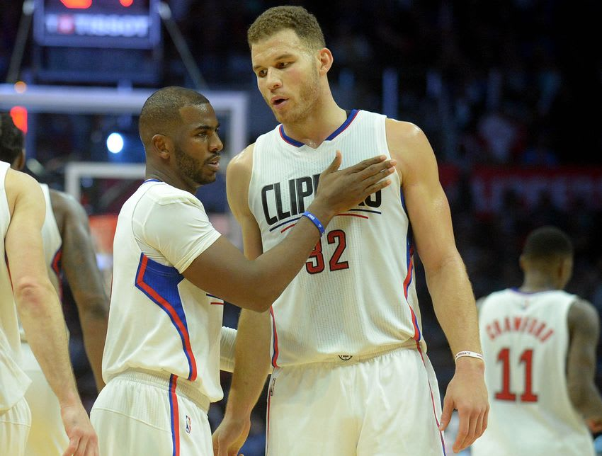 November 21, 2016; Los Angeles, CA, USA; Los Angeles Clippers guard Chris Paul (3) reacts with forward Blake Griffin (32) against the Toronto Raptors during the second half at Staples Center. Mandatory Credit: Gary A. Vasquez-USA TODAY Sports