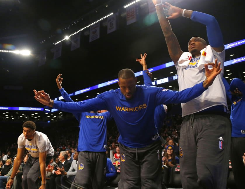 Dec 6, 2015; Brooklyn, NY, USA; Golden State Warriors forward Andre Iguodala (9) reacts with the bench after a three point shot by the Golden State Warriors during the first half against the Brooklyn Nets at Barclays Center. Mandatory Credit: Noah K. Murray-USA TODAY Sports