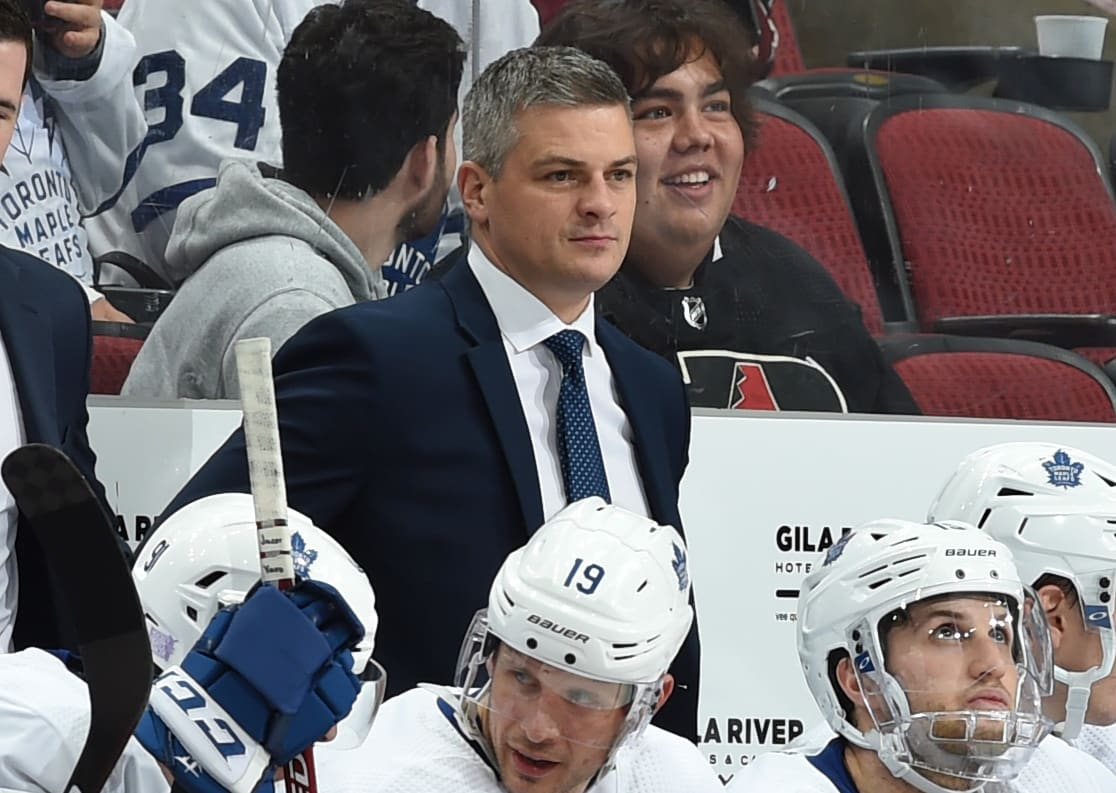 GLENDALE, ARIZONA - NOVEMBER 21: Head coach Sheldon Keefe of the Toronto Maple Leafs looks on from the bench during a game against the Arizona Coyotes at Gila River Arena on November 21, 2019 in Glendale, Arizona. The game was Keefe's first game as an NHL head coach. (Photo by Norm Hall/NHLI via Getty Images)