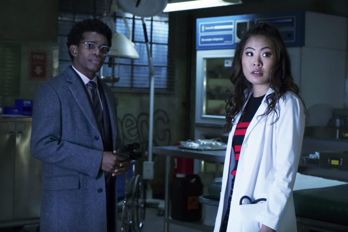 "Batwoman -- ""Off With Her Head"" -- Image Number: BWN115a_0042b -- Pictured (L-R): Camrus Johnson as Luke Fox and Nicole Kang as Mary Hamilton -- Photo: Shane Harvey/The CW -- © 2020 The CW Network, LLC. All rights reserved."