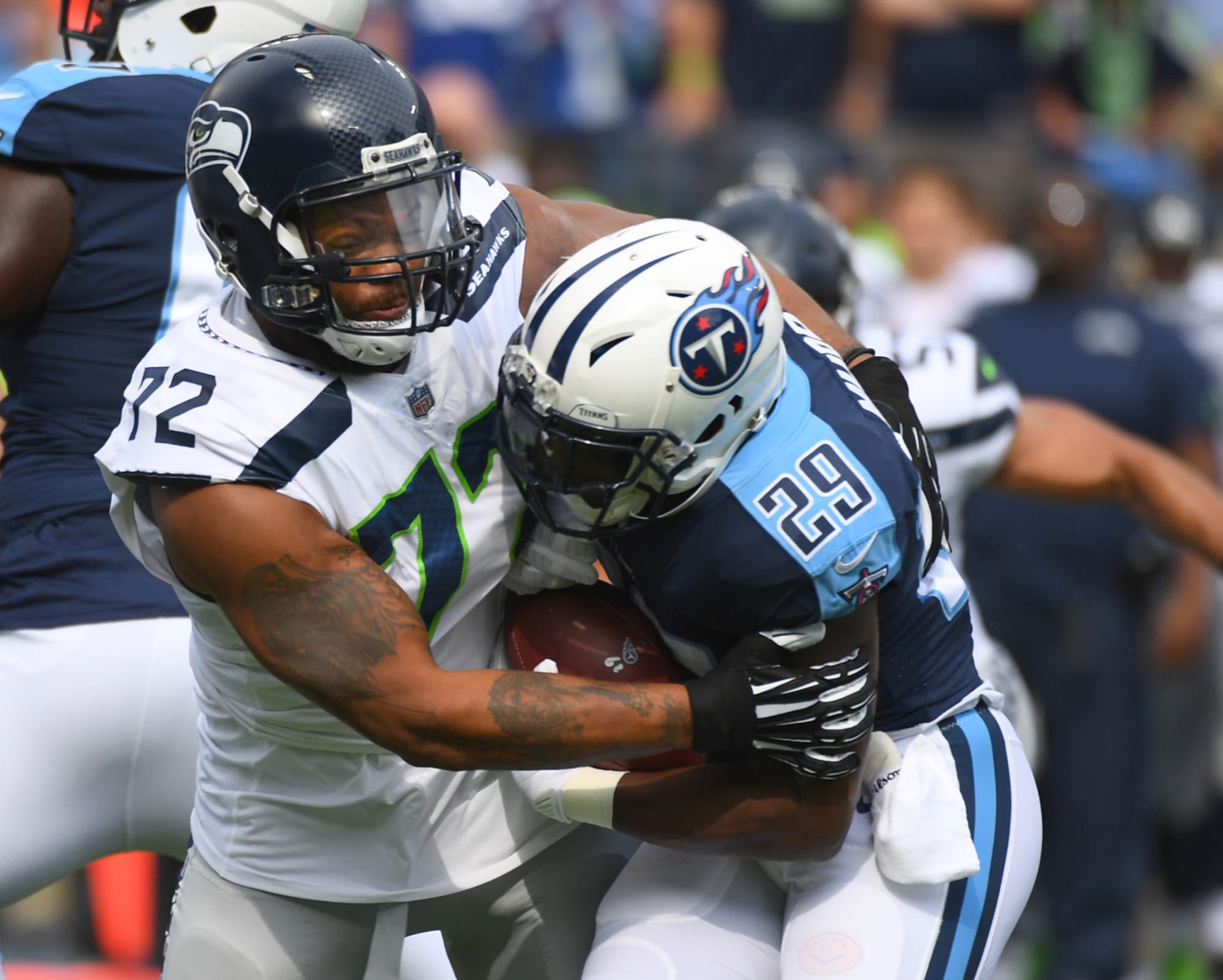 Seahawks vs Titans: Our staff predicts a successful Seattle Sunday