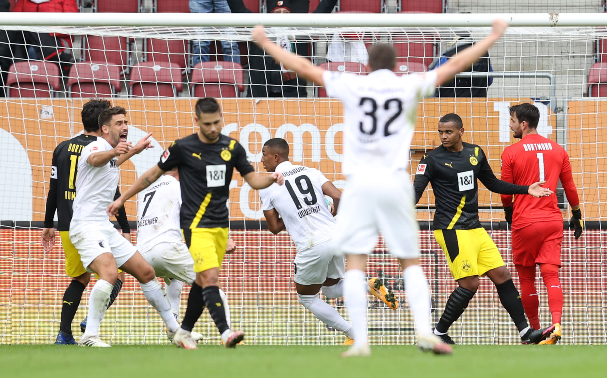 Uninspired Borussia Dortmund handed 2-0 defeat by Augsburg