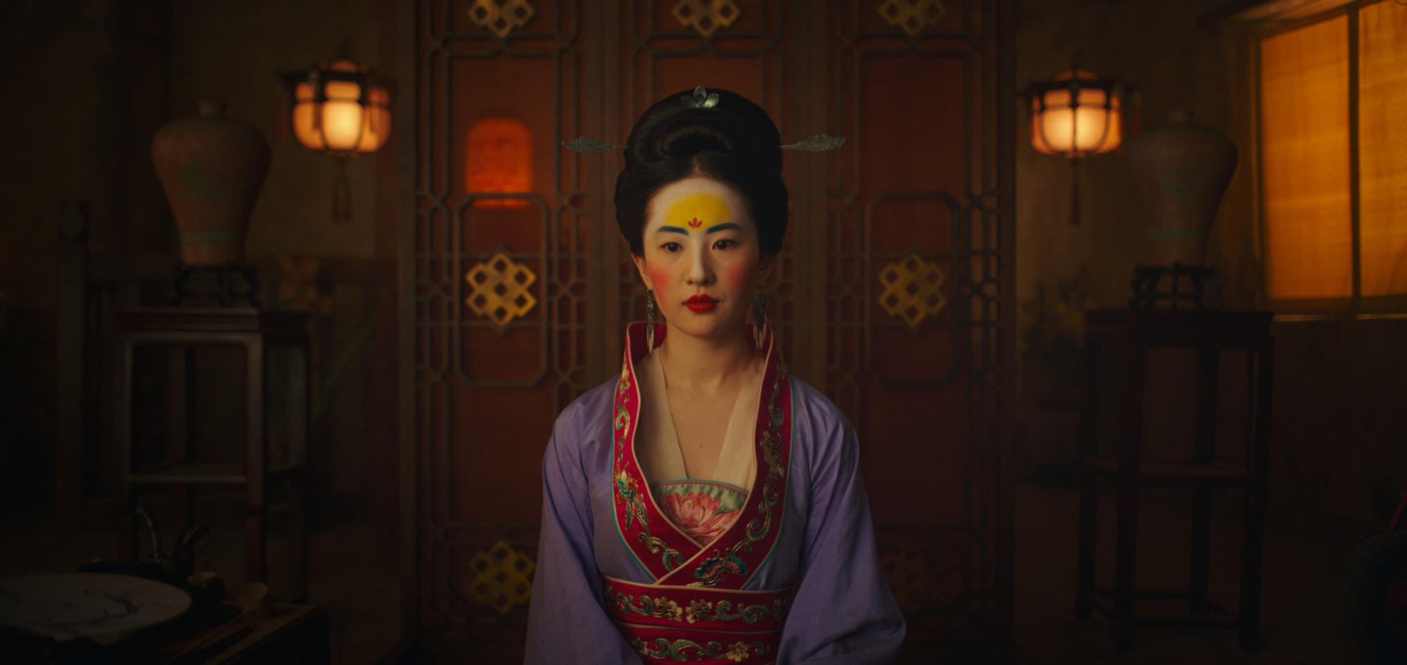 historical movie costumes, Mulan's costume was very bright. It was also inspired by a different era as the one the original story was set in.