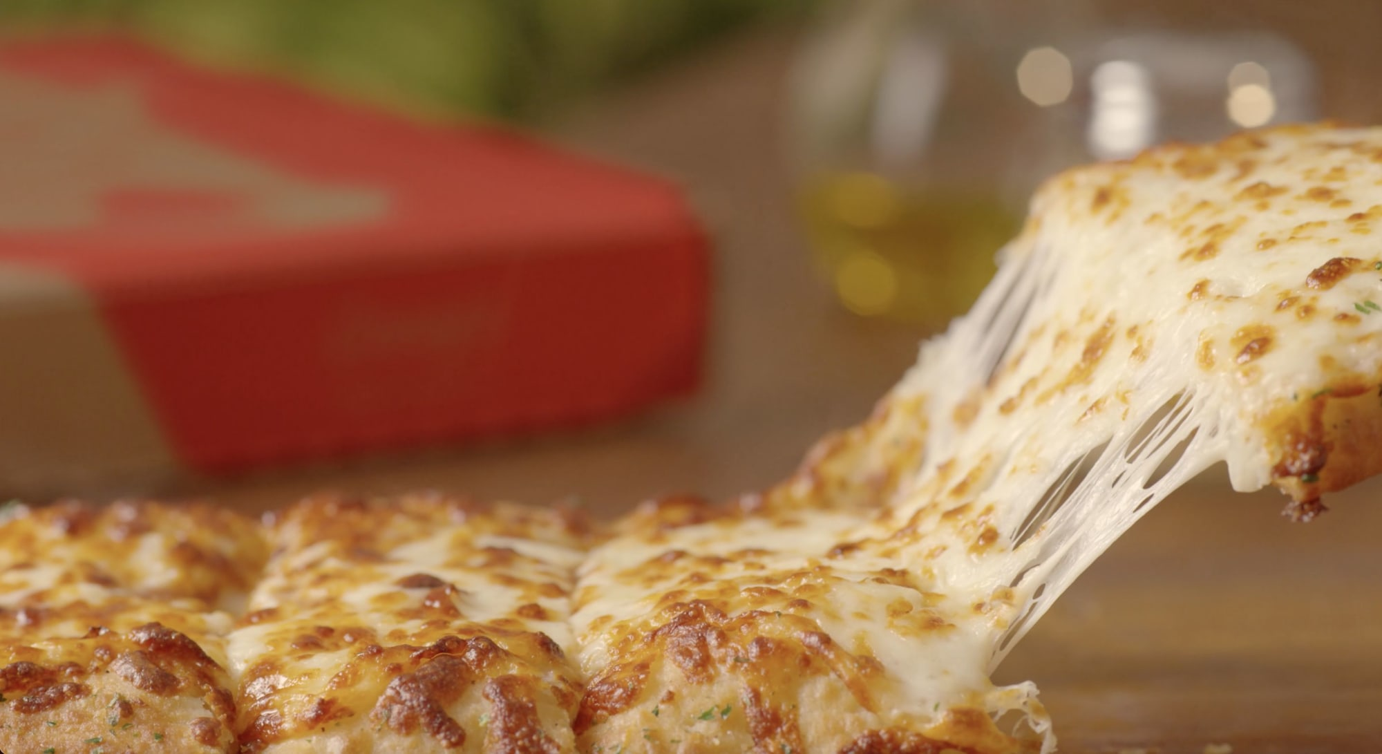 Joel McHale reveals Casey's Cheesy Breadsticks are tasty, and that's no joke