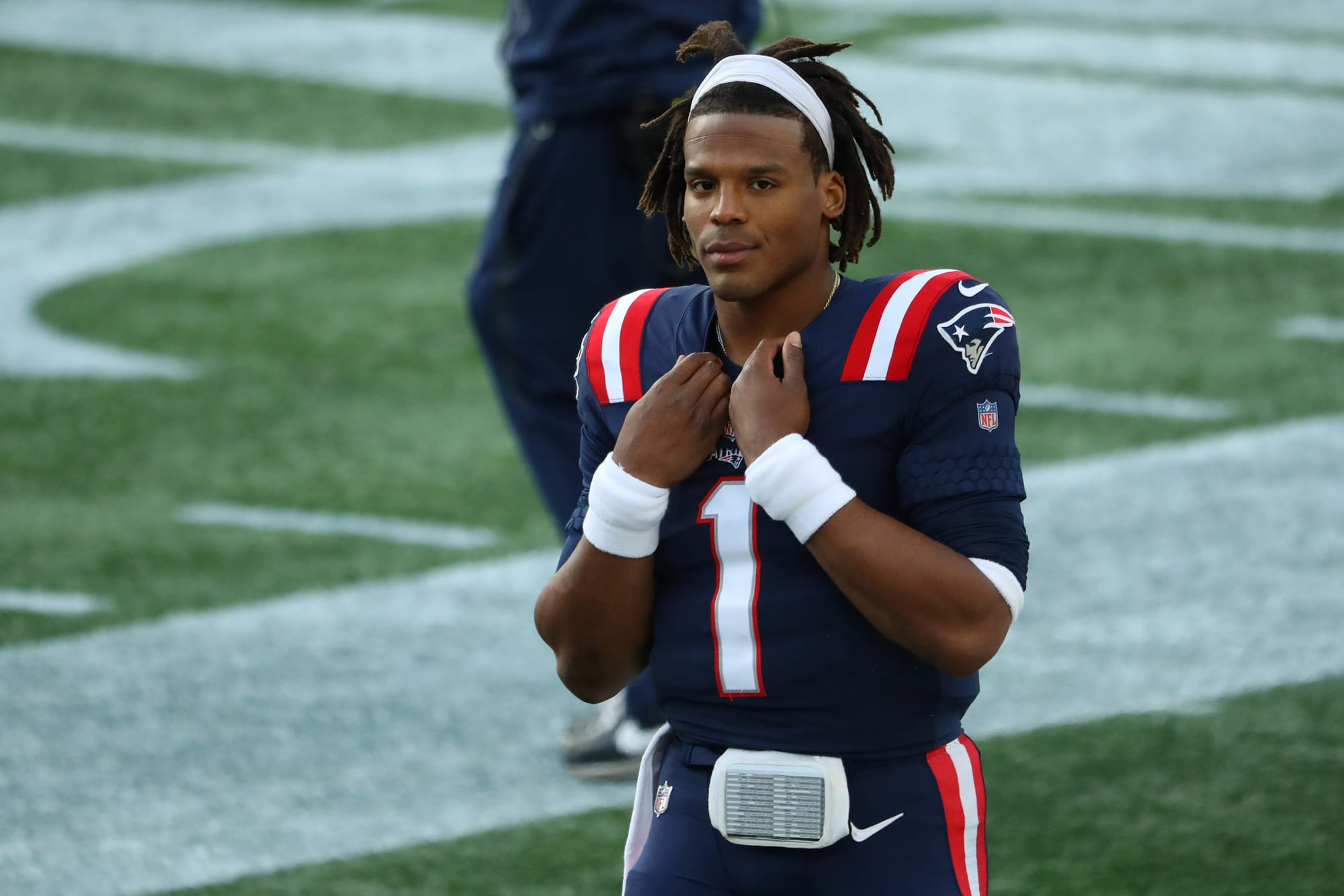 Cam Newton looks on at a game during his time with the New England Patriots