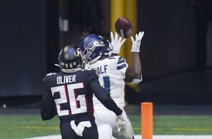 Sep 13, 2020; Atlanta, Georgia, USA; Seattle Seahawks wide receiver DK Metcalf (14) catches a touchdown pass behind Atlanta Falcons cornerback Isaiah Oliver (26) during the second half at Mercedes-Benz Stadium. Mandatory Credit: Dale Zanine-USA TODAY Sports