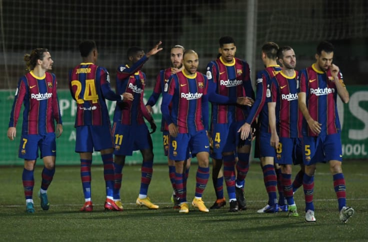 Ousmane Dembele of Barcelona celebrates with teammates. (Photo by Alex Caparros/Getty Images)
