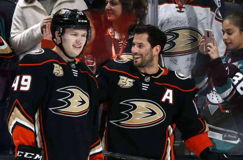 ANAHEIM, CA - APRIL 05: Max Jones #49 and Adam Henrique #14 of the Anaheim Ducks chat during warm-ups prior to the game against the Los Angeles Kings on April 5, 2019 at Honda Center in Anaheim, California. (Photo by Debora Robinson/NHLI via Getty Images)