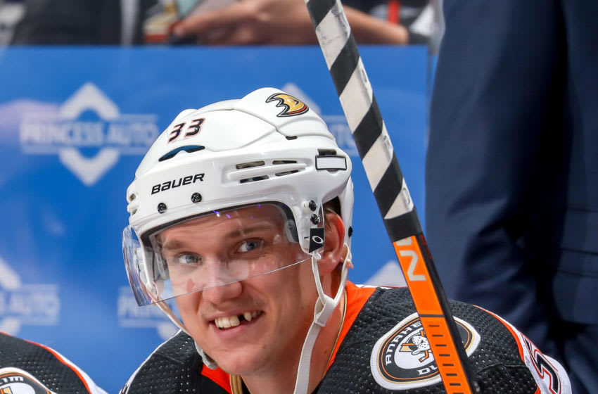 WINNIPEG, MB - DECEMBER 8: Jakob Silfverberg #33 of the Anaheim Ducks is all smiles as he looks on from the bench prior to puck drop against the Winnipeg Jets at the Bell MTS Place on December 8, 2019 in Winnipeg, Manitoba, Canada. (Photo by Jonathan Kozub/NHLI via Getty Images)
