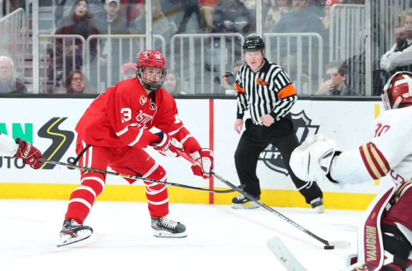 BOSTON, MA - FEBRUARY 03: Boston University Terriers forward Trevor Zegras (13) takes a shot on goal during the game between Boston College and Boston University on February 03, 2020, at TD Garden in Boston, Massachusetts. (Photo by Mark Box/Icon Sportswire via Getty Images)