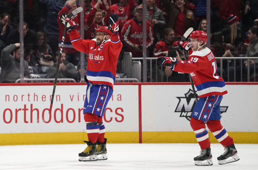 WASHINGTON, DC - JANUARY 16: Alex Ovechkin #8 of the Washington Capitals celebrates with teammate Nicklas Backstrom #19 after scoring his third goal of the game for a hat trick against the New Jersey Devils in the third period at Capital One Arena on January 16, 2020 in Washington, DC. (Photo by Patrick McDermott/NHLI via Getty Images)
