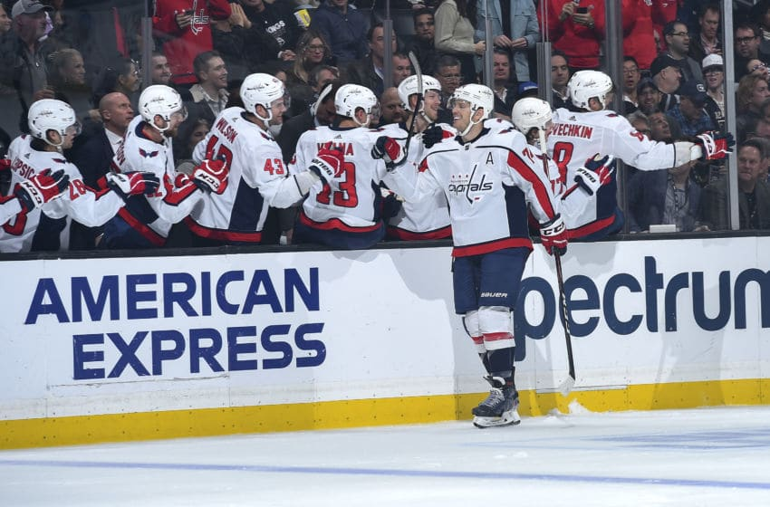 LOS ANGELES, CA - DECEMBER 4: John Carlson #74 of the Washington Capitals celebrates his goal with teammates during the first period against the Los Angeles Kings at STAPLES Center on December 4, 2019 in Los Angeles, California. (Photo by Andrew D. Bernstein/NHLI via Getty Images)