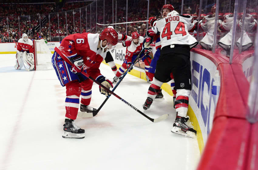 WASHINGTON, DC - JANUARY 11: Miles Wood #44 of the New Jersey Devils checks Richard Panik #14 of the Washington Capitals in the second period at Capital One Arena on January 11, 2020 in Washington, DC. (Photo by Patrick McDermott/NHLI via Getty Images)