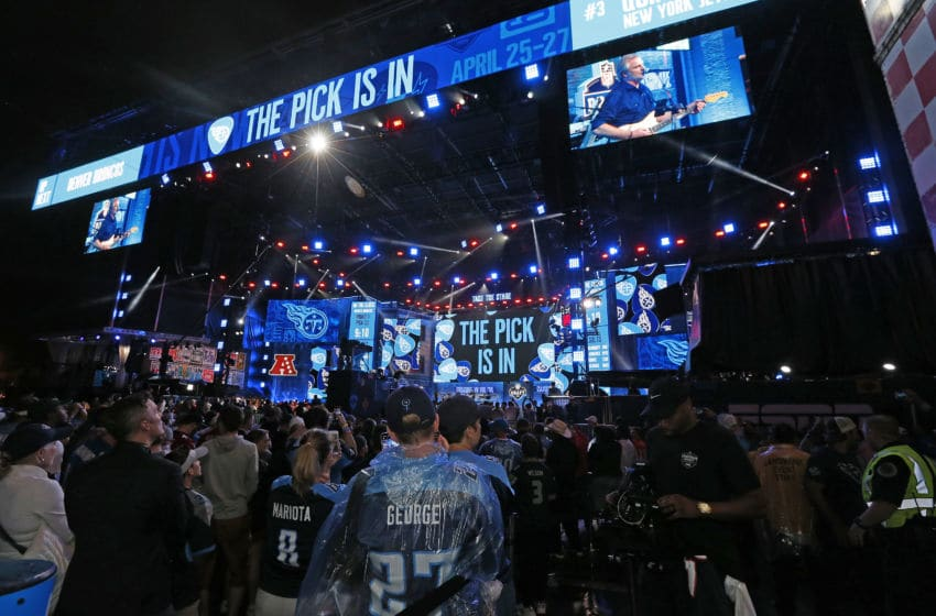 NASHVILLE, TENNESSEE - APRIL 25: Hometown fans of the Tennessee Titans react after their first round pick of Jeffery Simmons is announced on day 1 of the 2019 NFL Draft on April 25, 2019 in Nashville, Tennessee. (Photo by Frederick Breedon/Getty Images)