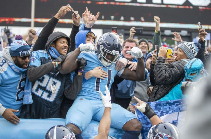 NASHVILLE, TN - DECEMBER 15: A.J. Brown #11 of the Tennessee Titans celebrates with the fans after scoring a touchdown in the second half of a game against the Houston Texans at Nissan Stadium on December 15, 2019 in Nashville, Tennessee. The Texans defeated the Titans 24-21. (Photo by Wesley Hitt/Getty Images)