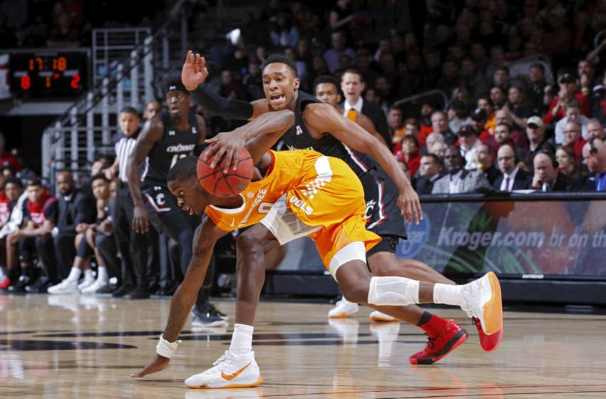 CINCINNATI, OH - DECEMBER 18: Mika Adams-Woods #3 of the Cincinnati Bearcats defends against Davonte Gaines #0 of the Tennessee Volunteers in the first half of the game at Fifth Third Arena on December 18, 2019 in Cincinnati, Ohio. Cincinnati defeated Tennessee 78-66. (Photo by Joe Robbins/Getty Images)
