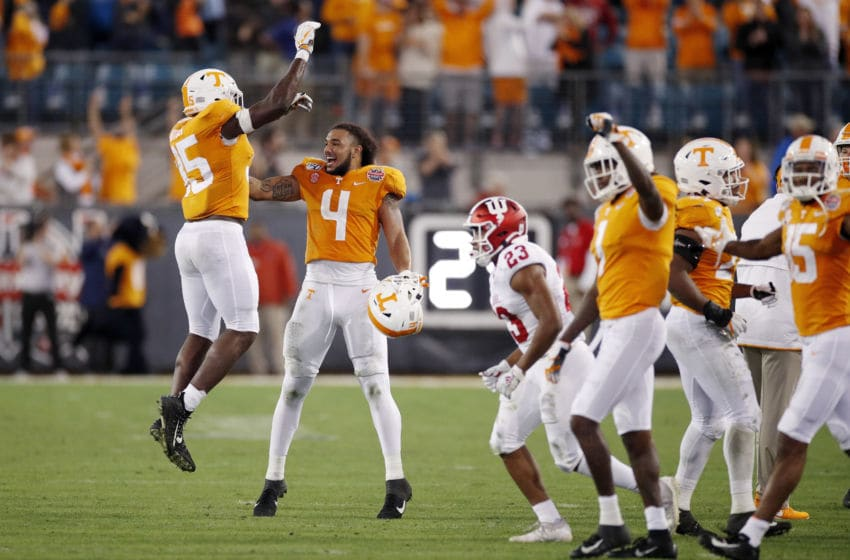 JACKSONVILLE, FL - JANUARY 02: Tennessee Volunteers players celebrate celebrate in the closing seconds of the TaxSlayer Gator Bowl against the Indiana Hoosiers at TIAA Bank Field on January 2, 2020 in Jacksonville, Florida. Tennessee defeated Indiana 23-22. (Photo by Joe Robbins/Getty Images)