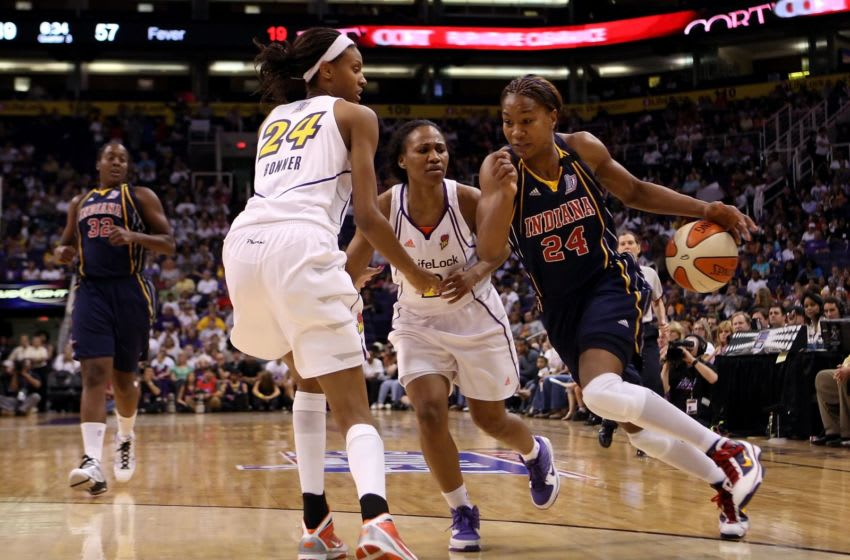 PHOENIX - OCTOBER 01: Tamika Catchings #24 of the Indiana Fever drives the ball against the Phoenix Mercury in Game Two of the 2009 WNBA Finals at US Airways Center on October 1, 2009 in Phoenix, Arizona. The Fever defeated the Mercury 94-83 to tie the series at 1-1. NOTE TO USER: User expressly acknowledges and agrees that, by downloading and or using this photograph, User is consenting to the terms and conditions of the Getty Images License Agreement. (Photo by Christian Petersen/Getty Images)