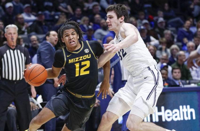 CINCINNATI, OH - NOVEMBER 12: Dru Smith #12 of the Missouri Tigers drives to the basket against Zach Freemantle #32 of the Xavier Musketeers during the first half at Cintas Center on November 12, 2019 in Cincinnati, Ohio. (Photo by Michael Hickey/Getty Images)