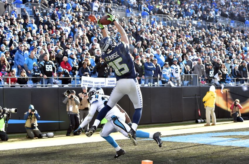 Jan 17, 2016; Charlotte, NC, USA; Seattle Seahawks wide receiver Jermaine Kearse (15) catches a 19 yard touchdown pass defended by Carolina Panthers defensive back Robert McClain (27) in the third quarter during the NFC Divisional round playoff game at Bank of America Stadium. Mandatory Credit: Bob Donnan-USA TODAY Sports
