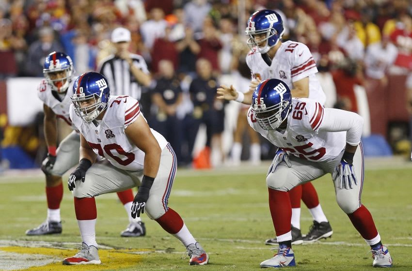 Sep 25, 2014; Landover, MD, USA; New York Giants tackle Will Beatty (65) and tackle Troy Kropog (70) line up against the Washington Redskins at FedEx Field. Mandatory Credit: Geoff Burke-USA TODAY Sports