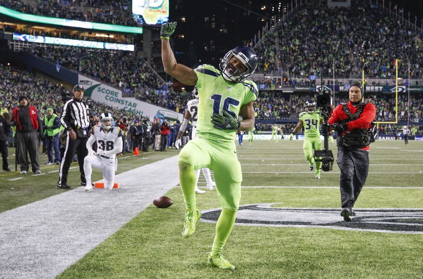 Dec 15, 2016; Seattle, WA, USA; Seattle Seahawks wide receiver Tyler Lockett (16) celebrates after catching a touchdown pass against the Los Angeles Rams during the fourth quarter at CenturyLink Field. Mandatory Credit: Joe Nicholson-USA TODAY Sports