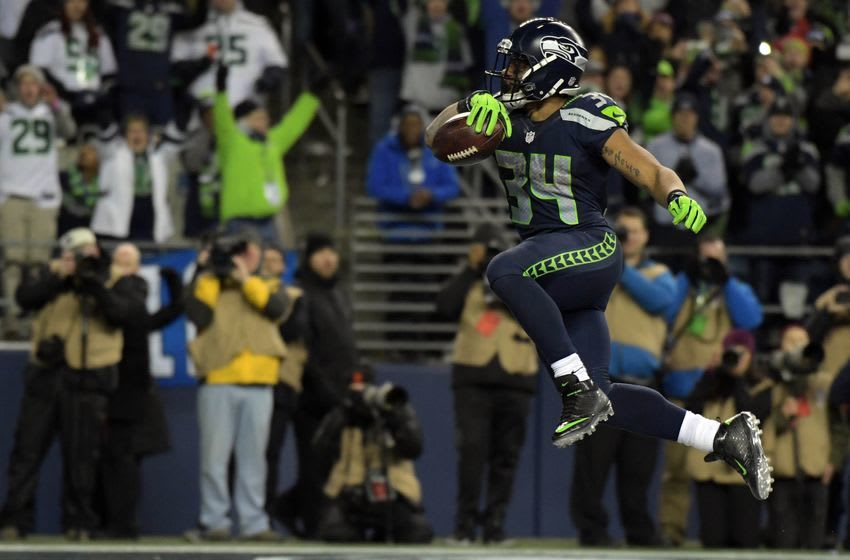 January 7, 2017; Seattle, WA, USA; Seattle Seahawks running back Thomas Rawls (34) moves the ball in for a touchdown against the Detroit Lions during the second half in the NFC Wild Card playoff football game at CenturyLink Field. Mandatory Credit: Kirby Lee-USA TODAY Sports