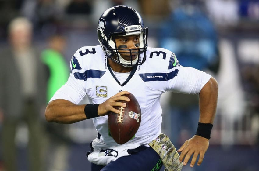FOXBORO, MA - NOVEMBER 13: Russell Wilson #3 of the Seattle Seahawks looks to throw the ball during the first quarter of a game against the New England Patriots at Gillette Stadium on November 13, 2016 in Foxboro, Massachusetts. (Photo by Adam Glanzman/Getty Images)