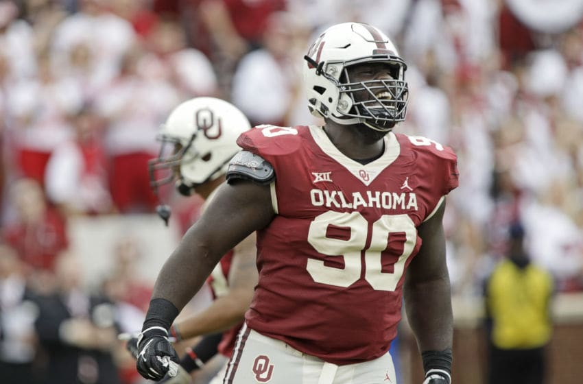 NORMAN, OK - SEPTEMBER 29: Defensive lineman Neville Gallimore #90 of the Oklahoma Sooners celebrates a quarterback sack against the Baylor Bears at Gaylord Family Oklahoma Memorial Stadium on September 29, 2018 in Norman, Oklahoma. (Photo by Brett Deering/Getty Images)