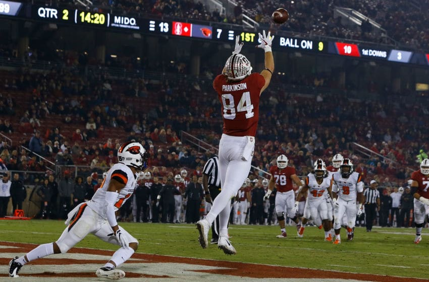 PALO ALTO, CA - NOVEMBER 10: Tight end Colby Parkinson #84 of the Stanford Cardinal catches a 5 yard pass for a touchdown in front of safety Jeffrey Manning Jr. #15 of the Oregon State Beavers during the second quarter at Stanford Stadium on November 10, 2018 in Palo Alto, California. The Stanford Cardinal defeated the Oregon State Beavers 48-17. (Photo by Jason O. Watson/Getty Images)