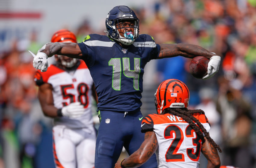 SEATTLE, WA - SEPTEMBER 08: Wide receiver DK Metcalf #14 of the Seattle Seahawks reacts after making a catch against safety Jessie Bates #30 and cornerback B.W Webb #23 of the Cincinnati Bengals in the third quarter at CenturyLink Field on September 8, 2019 in Seattle, Washington. (Photo by Otto Greule Jr/Getty Images)