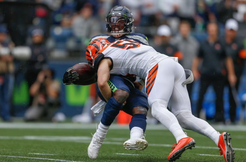 SEATTLE, WA - SEPTEMBER 08: Running back Chris Carson #32 of the Seattle Seahawks is tackled by linebacker Nick Vigil #59 of the Cincinnati Bengals at CenturyLink Field on September 8, 2019 in Seattle, Washington. (Photo by Otto Greule Jr/Getty Images)