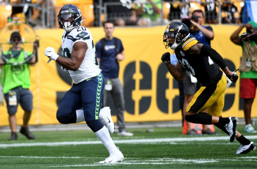 PITTSBURGH, PA - SEPTEMBER 15: Rashaad Penny #20 of the Seattle Seahawks runs for a 37-yard touchdown in the third quarter during the game against the Pittsburgh Steelers at Heinz Field on September 15, 2019 in Pittsburgh, Pennsylvania. (Photo by Justin Berl/Getty Images)