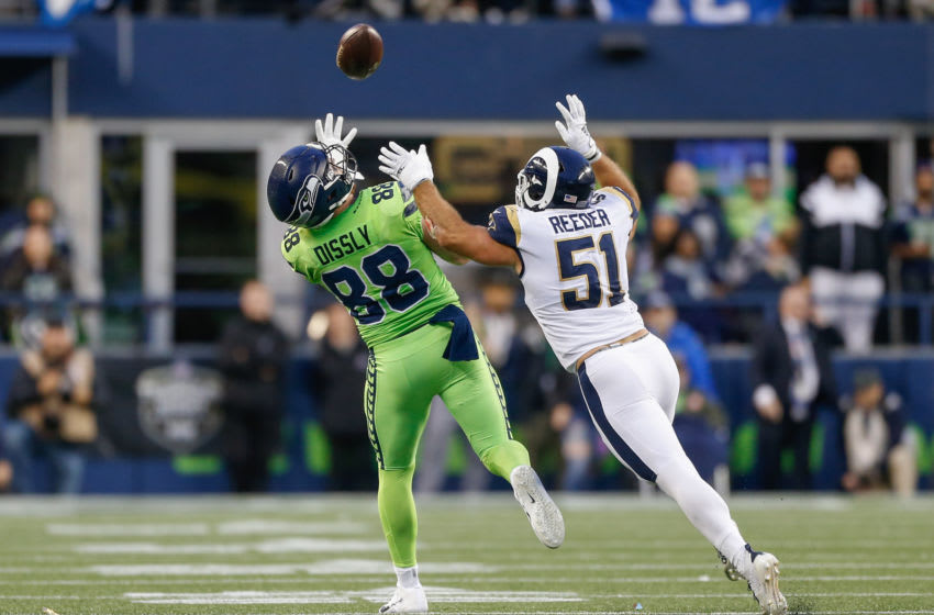 SEATTLE, WA - OCTOBER 03: Tight end Will Dissly #88 of the Seattle Seahawks makes a 25-yard catch against Troy Reeder #51 of the Los Angeles Rams in the first half at CenturyLink Field on October 3, 2019 in Seattle, Washington. (Photo by Otto Greule Jr/Getty Images)