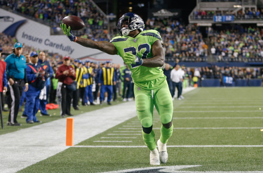 SEATTLE, WA - OCTOBER 03: Running back Chris Carson #32 of the Seattle Seahawks makes a touchdown catch in the fourth quarter against the Los Angeles Rams at CenturyLink Field on October 3, 2019 in Seattle, Washington. (Photo by Otto Greule Jr/Getty Images)
