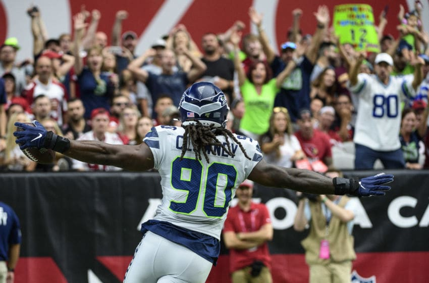 GLENDALE, ARIZONA - SEPTEMBER 29: Outside linebacker Jadeveon Clowney #90 of the Seattle Seahawks runs in an interception for a touchdown in the first half of the NFL game against the Arizona Cardinals at State Farm Stadium on September 29, 2019 in Glendale, Arizona. (Photo by Jennifer Stewart/Getty Images)